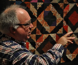 Robert Shaw discussing a quilt