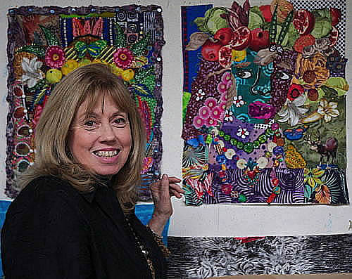 Jane Burch Cochran with two of her recent Face quilts